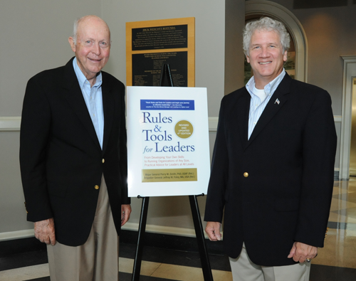 Perry Smith and Jeff Foley with a poster of their book