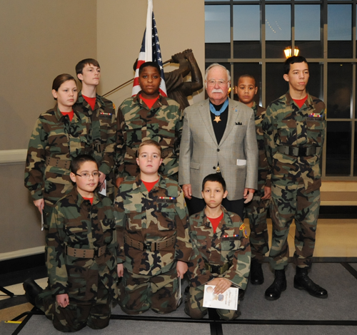 Medal of Honor recipient Barney Barnum, poses afterwards with local ROTC students