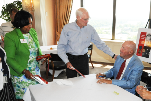 Perry Smith signs books after a special luncheon June 23, 2015 at the Pinnacle Club